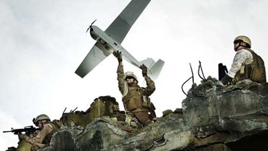 A soldier launches the Puma unmanned vehicle.