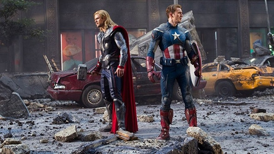 Two Avengers survey a partially destroyed New York, the work of a self-powered energy vortex thingy.