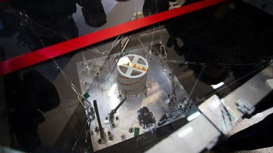 Feb. 29, 2012: A qualification model of the Navid-1 satellite is displayed for journalists during a visit to the Iranian Space Agency (ISA) in Mahdasht, about 60 km west of Tehran.