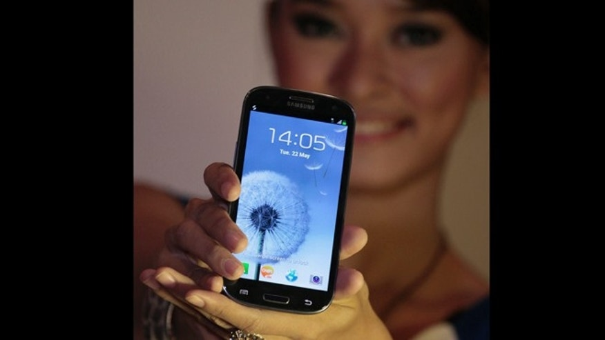 May 22, 2012: A model displays a Samsung Galaxy S III, the latest smartphone in the company's Galaxy lineups, during its launching for media in Jakarta, Indonesia.
