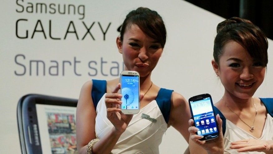 May 22, 2012: Models display the Samsung Galaxy S III during its launching for media in Jakarta, Indonesia.