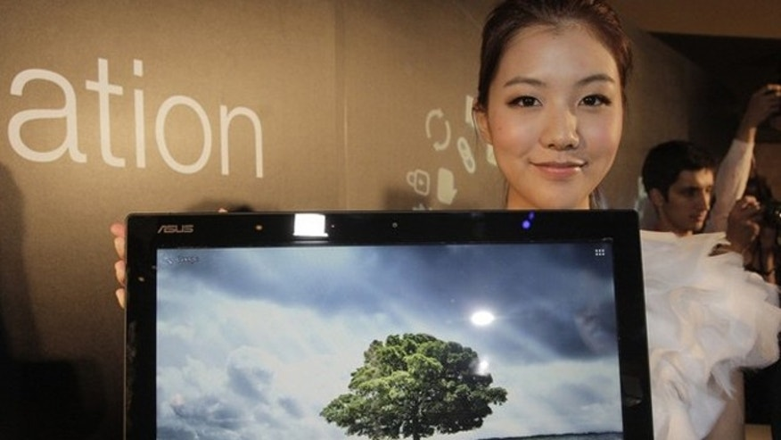 A model displays the ASUS Transformer AiO, an 18.4-inch device combined tablet and PC, during a news conference at a media preview of the 2012 Computex exhibition in Taipei June 4, 2012. Computex, the world's second largest show, runs from June 5 to 9.