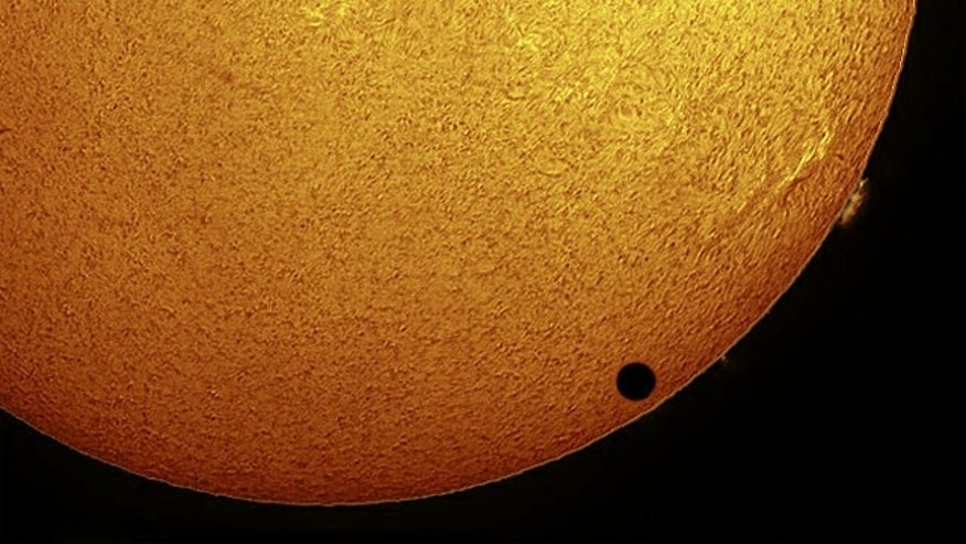 Paul Hyndman captured this stunning view of Venus crossing the face of the sun in hydrogen-alpha light on the morning of June 8, 2004 from Roxbury, Connecticut.