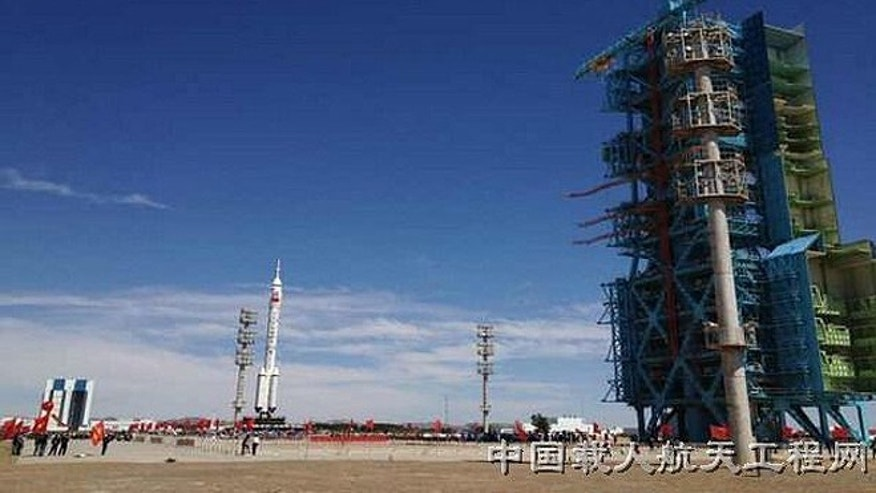 A Long March 2F rocket carrying the Shenzhou 9 rocket rolls out to the launch pad at China&#39&#x3b;s Jiuquan Satellite Launch Center ahead of a planned June 2012 launch of the country&#39&#x3b;s first manned space docking mission.
