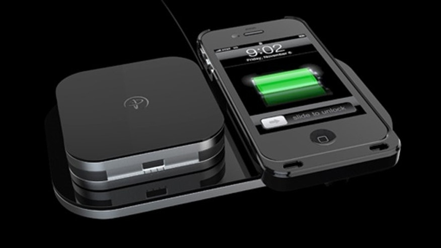 June 11, 2012: With Duracell Powermat's new system, drop an iPhone on a power pad to wirelessly recharge the smartphone.