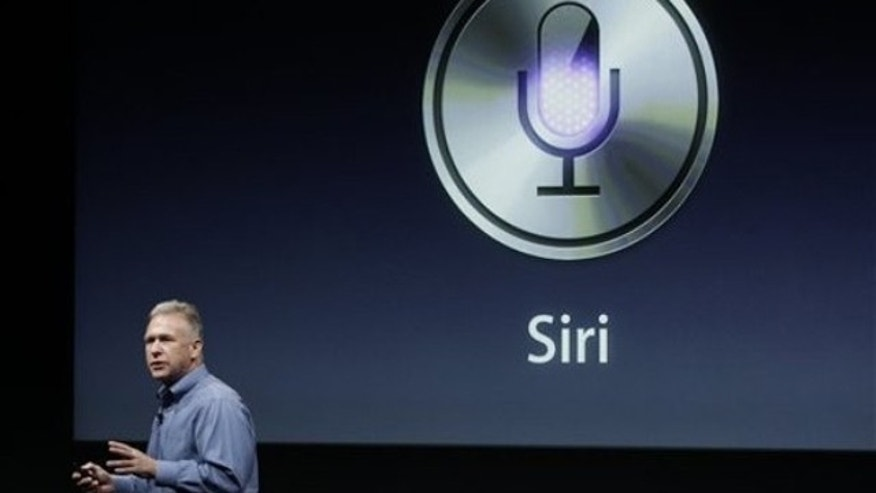Oct. 4, 2011: Apple's Phil Schiller talks about Siri with the new Apple iPhone 4S during an announcement at Apple headquarters in Cupertino, Calif.