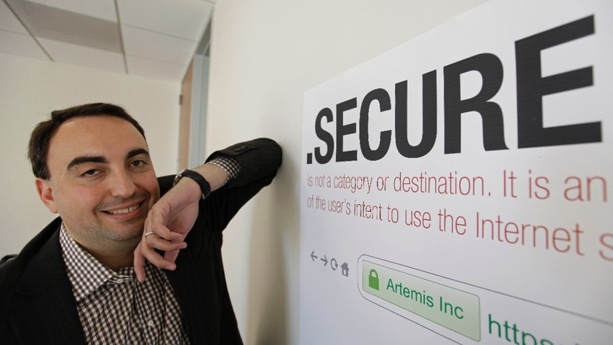 June 8, 2012: Alex Stamos CTO of Artemis Internet, an NCC Group Company, poses by a domain name poster at their offices in San Francisco. Some 2,000 proposals have been submitted as part of the largest expansion of the Internet address system since its creation in the 1980s.