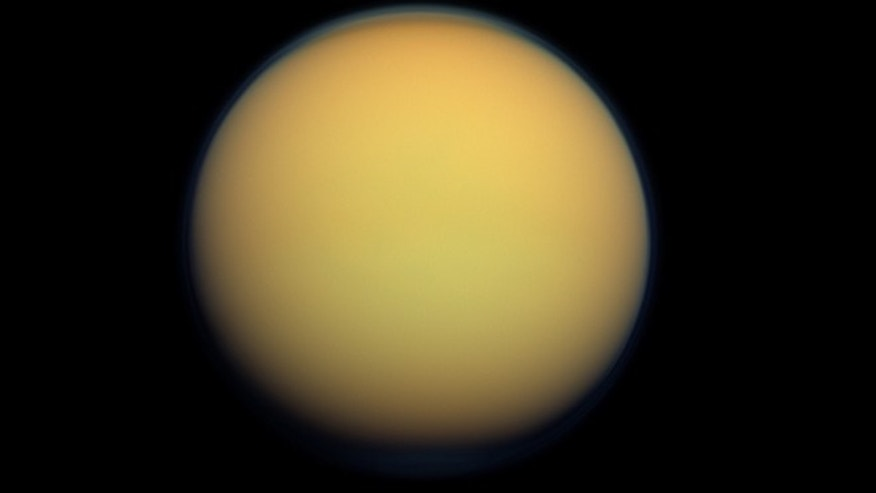Saturn's largest moon, Titan. A new study suggests the presence of a hydrocarbon lake and several ponds near the equator of Titan, a surprise to scientists who thought lakes only existed at the poles.