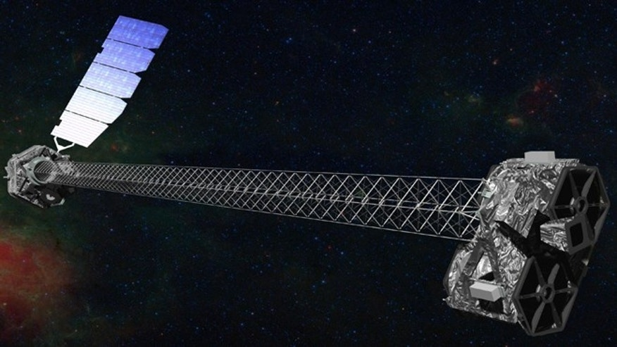 An artist rendering of the space agency's latest X-ray telescope. NuStar is set to launch on a two-year mission on Wednesday June 13, 2012, from the Kwajalein Atoll in the Pacific to study black holes and other celestial objects.