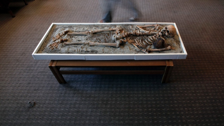 June 14, 2012: A man passes a displayed skeleton dating back to the Middle Ages and recently unearthed in the black sea town of Sozopol, at National History Museum in Sofia. Ever since archaeologists announced last week that they had found two ancient skeletons in Bulgaria with iron rods thrust through their chests, the media have been reporting how Bulgarians once did that to prevent the dead from emerging from the grave as vampires.