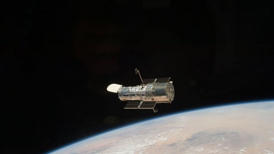The Hubble Space Telescope got one last overhaul in May 2009 by NASA astronauts on the space shuttle Atlantis and has been sending home stunning new photos ever since. Seen here, the iconic space telescope orbits high above the Earth, after it