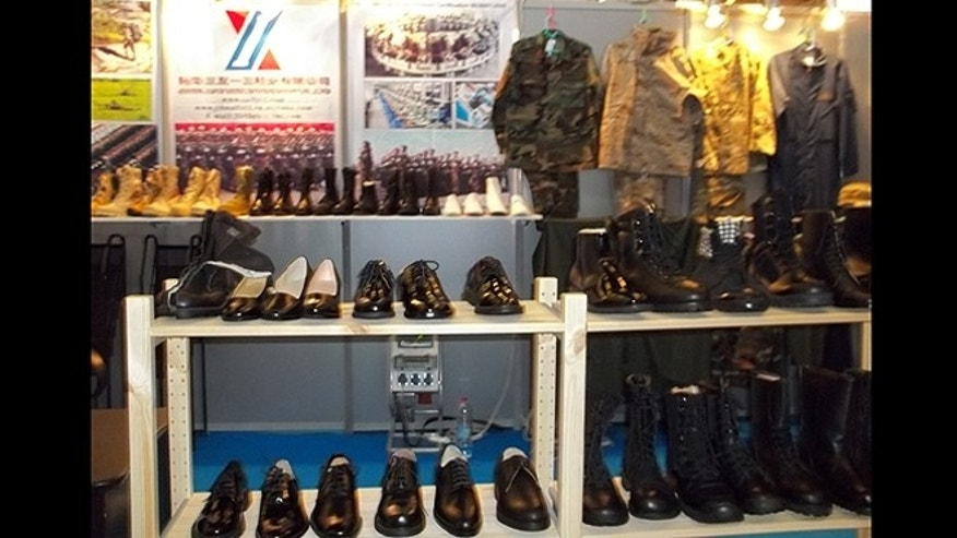 A military supply company from China shows off boots, dress shoes and riot gear to the world at the Eurosatory 2012 show in Paris.