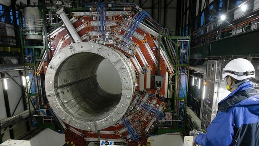 The giant Compact Muon Solenoid (CMS) magnet is placed underground in the Large Hadron Collider (LHC) accelerator at CERN, the European Particle Physics laboratory, in Cressy near Geneva, France.