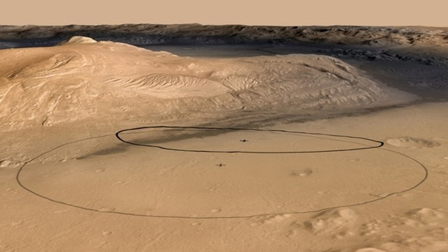 This image shows changes in the target landing area for Curiosity. The larger ellipse was the target area prior to early June 2012, when the project revised it to the smaller ellipse centered nearer to the foot of Mount Sharp, inside Gale Crater.