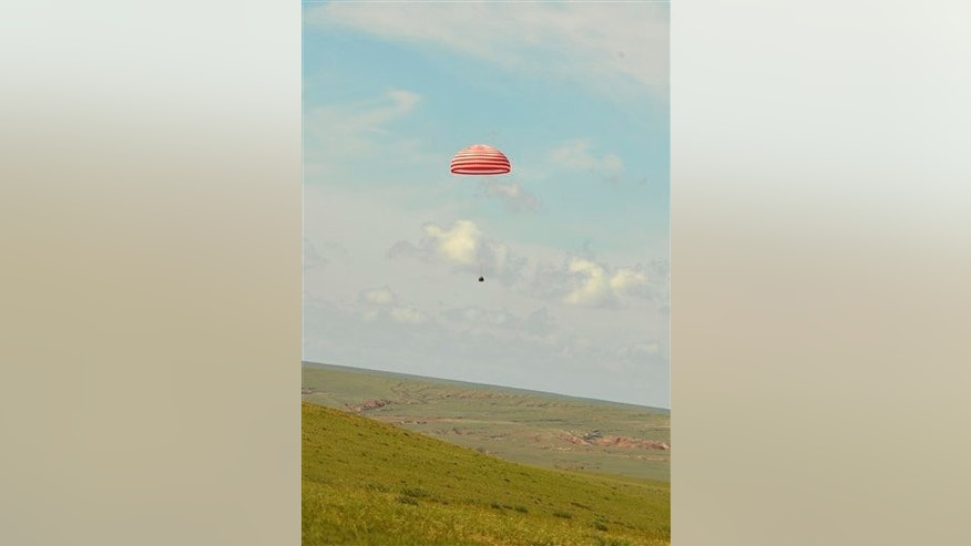 Friday, June 29, 2012: Shenzhou 9 spacecraft touching down in Siziwang Banner of north China's Inner Mongolia Autonomous Region.