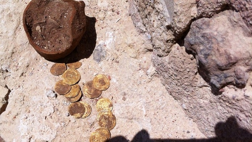 June 25, 2012: A stash of gold coins was found buried at Apllonia National Park, hidden away by Crusaders in the mid 1200s, archaeologists said.