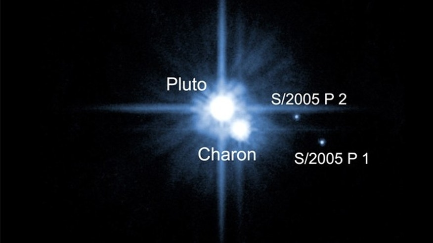 The moons of Pluto as scientists thought of them in 2006, when the Hubble telescope picked out the third and fourth moons.