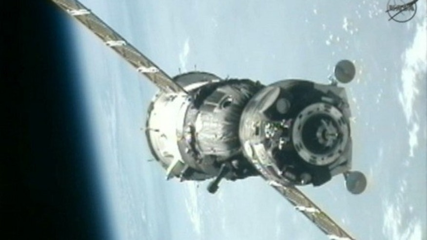 July 17, 2012: A Russian Soyuz spacecraft nears the ISS with the blue Earth in the background in this view from a station camera during docking of the Expedition 32 crew.