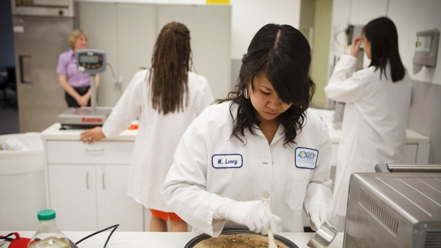 July 3, 2012: Lockheed Martin associate research scientist Monica Leong, prepares and bakes a vegan pizza from a recipe developed for a mission to Mars.