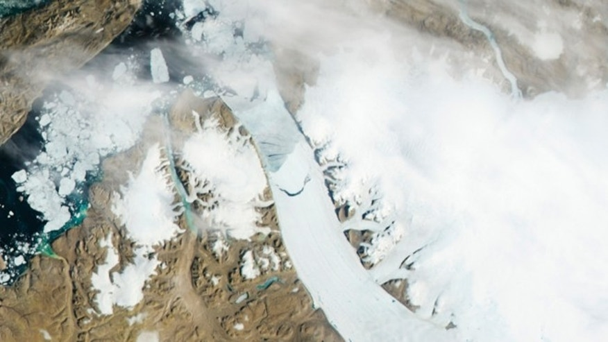 July 16, 2012: Calving, the crescent-shaped crack at center of this photo, is seen in the Petermann Glacier in northwestern Greenland, where an iceberg twice the size of Manhattan tore off one of the largest glaciers.