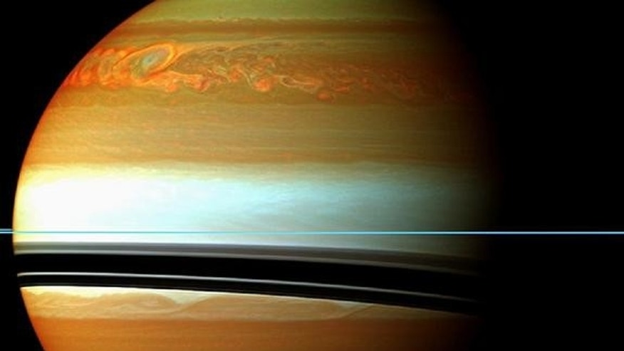 This false-color mosaic from NASA's Cassini spacecraft shows the tail of Saturn's huge northern storm.