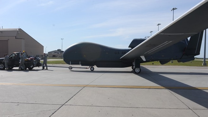Sept. 19, 2012: A RQ-4 Global Hawk is moved on the flight line on Grand Forks Air Force Base.