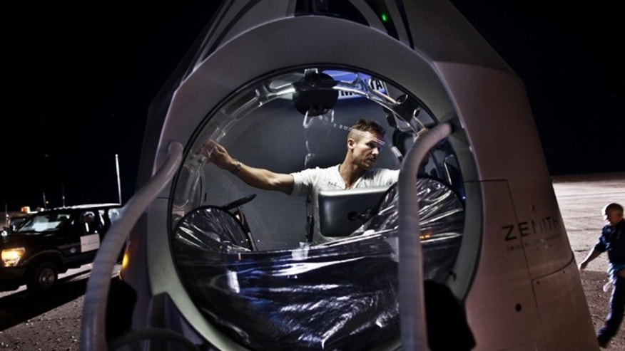 July 21, 2012: Pilot Felix Baumgartner of Austria sits inside the capsule prior to the second manned test flight for his Red Bull Stratos freefall from space in Roswell, N.M.