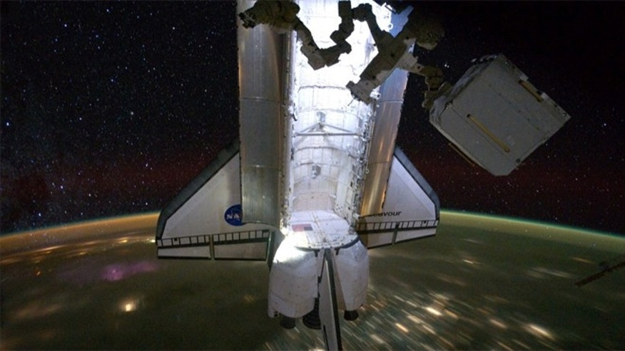 The $2 billion AMS experiment being removed from space shuttle Endeavour's cargo bay at the International Space Station.
