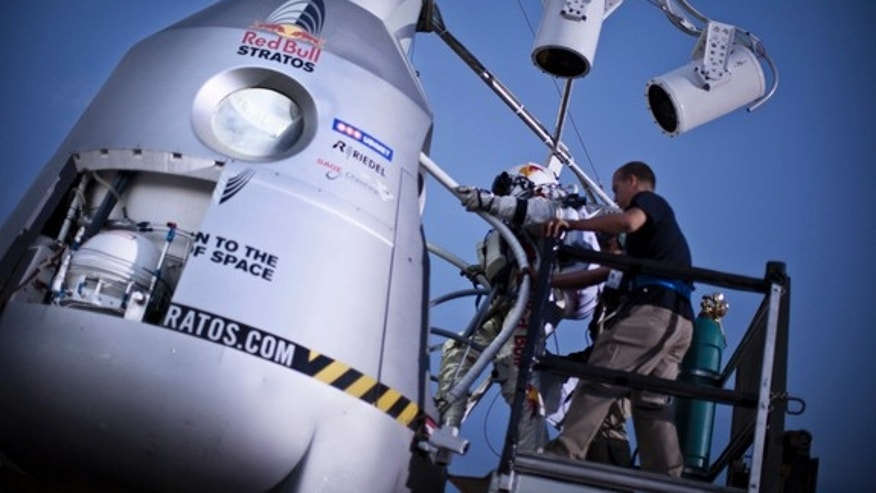 Pilot Felix Baumgartner of Austria steps in the capsule during the second manned test flight for Red Bull Stratos in Roswell, New Mexico, USA on July 25, 2012.àRed Bull Stratos is a mission to the edge of space to an altitude of 37.000 meters to break several records including the sound of speed in freefall. // balazsgardi.com/Red Bull Content Pool // P-20120725-00208 // Usage for editorial use only // Please go to www.redbullcontentpool.com for further information. //