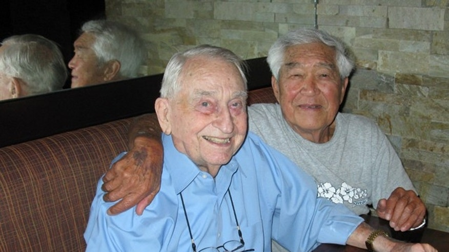 Apr. 18, 2012: George Yoshitake, an 83-year-old former Department of Defense cameraman, and 88-year old Major Don Luttrell share a drink, 55 years after standing directly under an exploding nuclear bomb.
