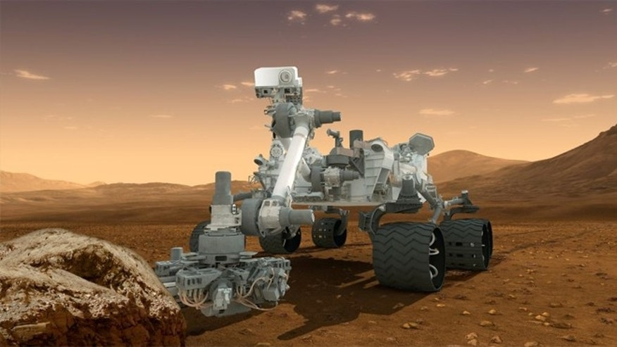 Artists concept depicts the NASA Mars Science Laboratory Curiosity rover, a nuclear-powered mobile robot for investigating the Red Planets past or present ability to sustain microbial life.