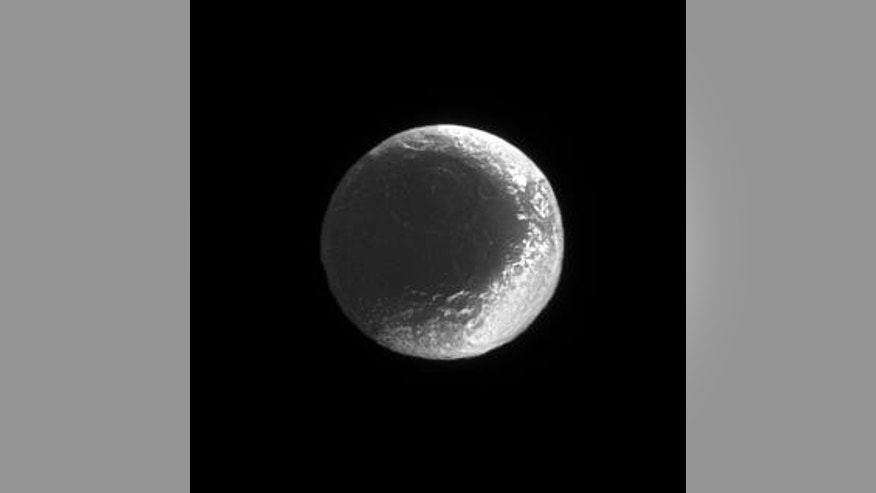 The equatorial ridge of Iapetus can reach heights of up to 12 miles (20 km). This image reveals mountains only about half that height.