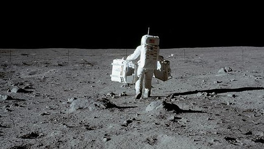 Apollo astronaut Buzz Aldrin collects moon rocks in 1969.