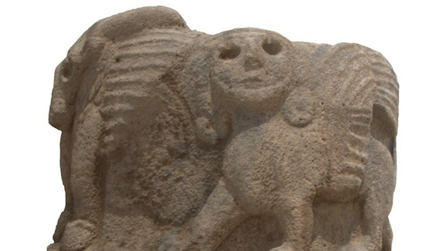 A column base excavated in southeastern Turkey bears a winged bull and carved sphinx.