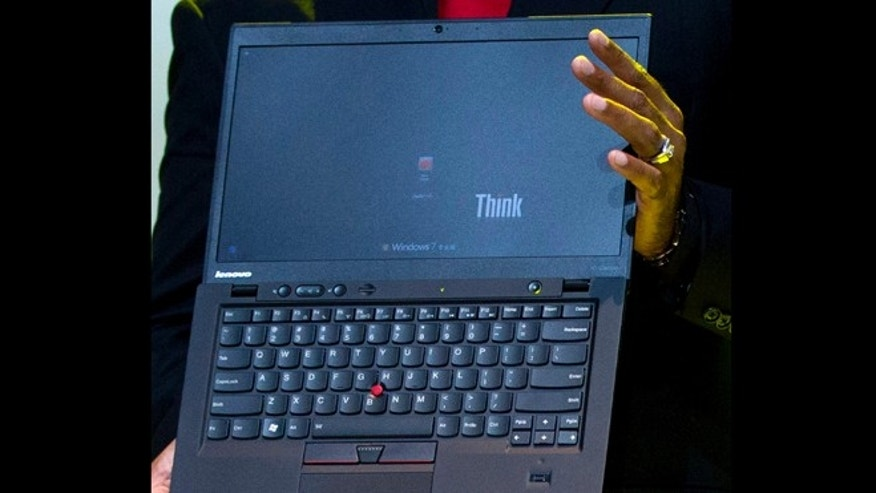Aug. 6, 2012: Lenovo Vice President Dilip Bhatia holds a new ThinkPad X1 Carbon laptop in Beijing.