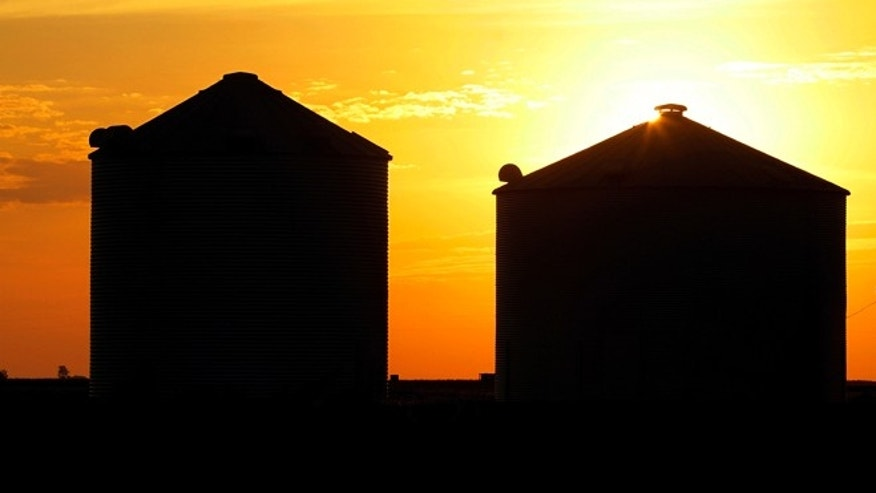July 22, 2012: The sun rises over grain silos in Ashland, Ill.