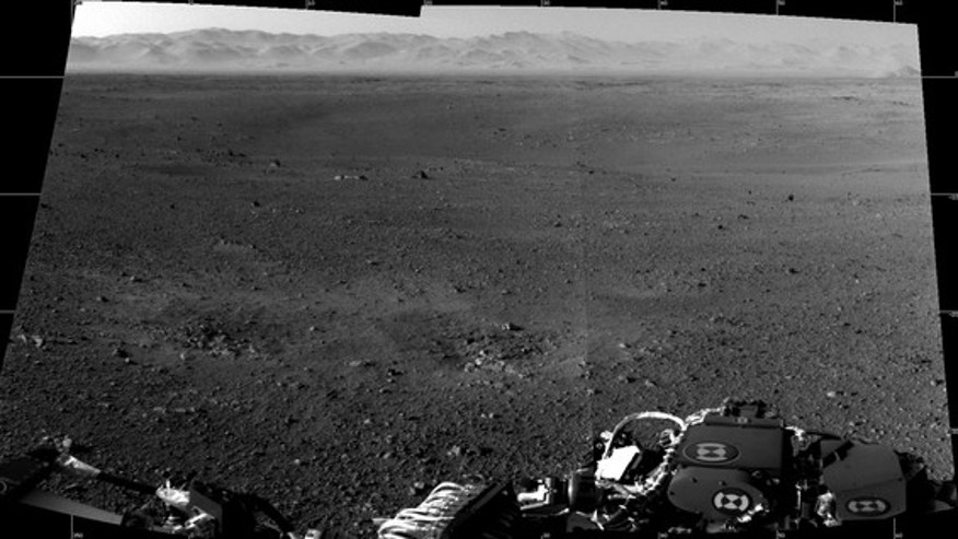 "These are the first two full-resolution images of the Martian surface from the Navigation cameras on NASA's Curiosity rover, which are located on the rover's ""head"" or mast. The rim of Gale Crater can be seen in the distance beyond the pebbly g"