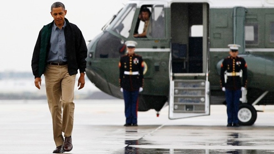 President Barack Obama walks from Marine One to board Air Force One at O&#39&#x3b;Hare International Airport in Chicago, Monday, Aug. 13, 2012 en route to Offutt Air Force Base in Bellevue, Neb., and onto a three day campaign bus tour through Iowa.