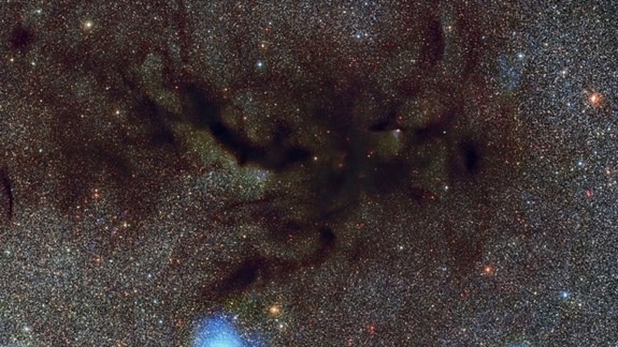 This picture shows Barnard 59, part of a vast dark cloud of interstellar dust called the Pipe Nebula nearly 600-700 light-years from Earth. This new and very detailed image of what is known as a dark nebula was captured by the Wide Field Imager