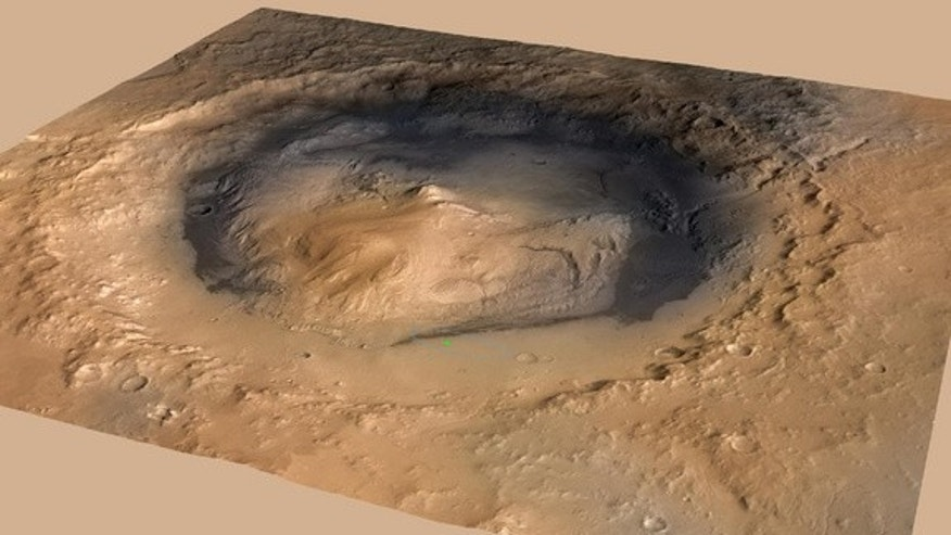 NASA's Curiosity rover landed in the Martian crater known as Gale Crater, which is approximately the size of Connecticut and Rhode Island combined. A green dot shows where the rover landed, well within its targeted landing ellipse, outlined in
