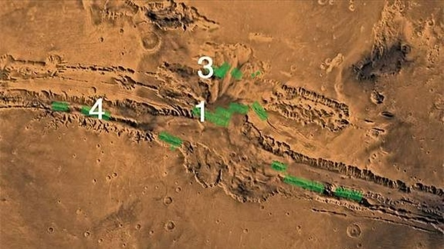 Mars' Valles Marineris canyons, where huge fault lines of rock (green) may have once been seeping with groundwater.