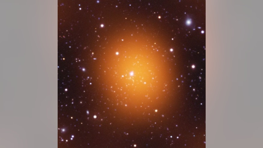 Microwave (orange), optical (red, green, blue) and ultraviolet (blue) image of Phoenix Cluster.
