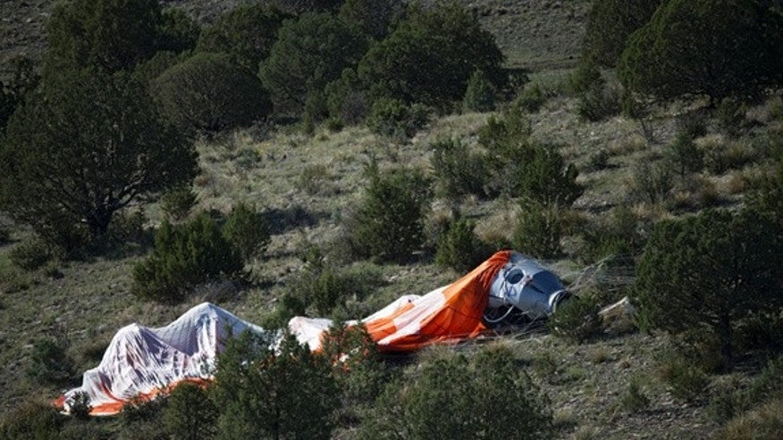 The capsule lies in the desert after a hard landing during the second manned test flight for Red Bull Stratos in Roswell, New Mexico, USA on July 25, 2012.