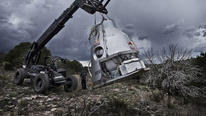 Crew members recover the capsule in the desert after the successfully compleated second manned test flight for Red Bull Stratos in Roswell, New Mexico, USA on July 25, 2012.