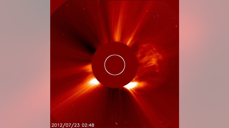 This image was captured by ESA and NASA's Solar and Heliospheric Observatory (SOHO) on July 22, 2012 at 10:48 p.m. EDT. On the right side, a cloud of solar material ejects from the sun in one of the fastest coronal mass ejections ever measured.