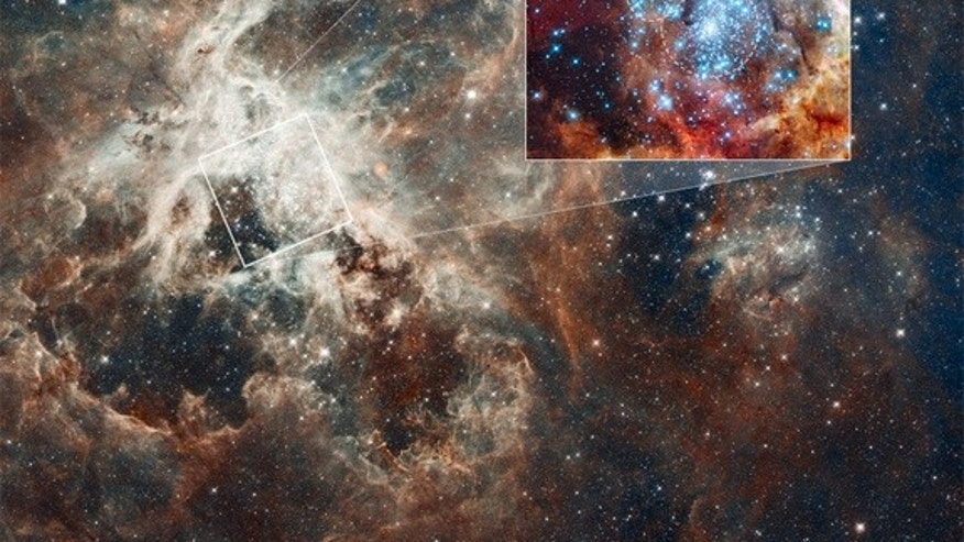 This is a Hubble Space Telescope image of a pair of star clusters that are believed to be in the early stages of colliding. The clusters lie in the gigantic 30 Doradus Nebula, which is 170,000 light-years from Earth. Image released August 16, 2
