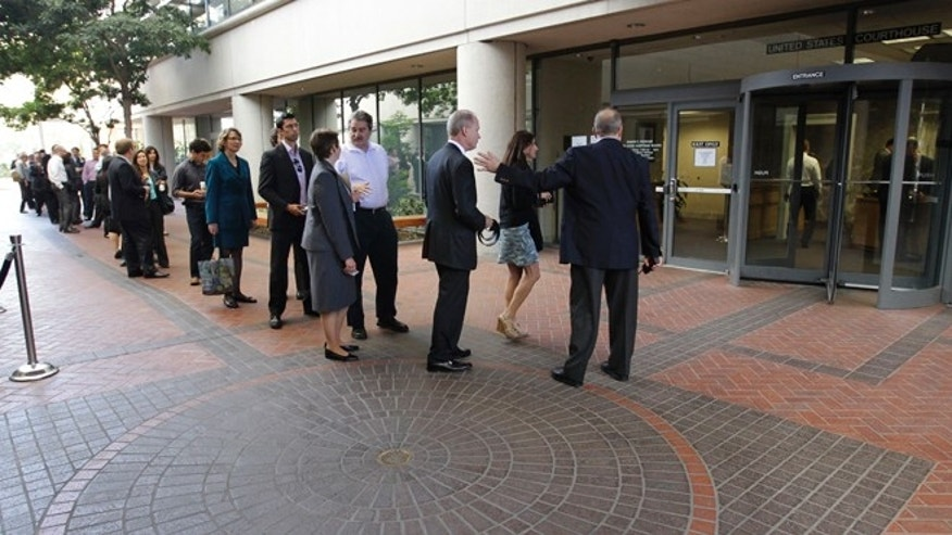 Aug. 21, 2012: People wait in line to get inside for the Apple and Samsung trial during a lunch break at a federal courthouse in San Jose, Calif. After three weeks of listening to technology experts, patent professionals and company executives debate the complicated legal claims of Apple Corp. and Samsung Electronics Co., a jury of nine men and women are set to decide one of the biggest technology disputes in history.