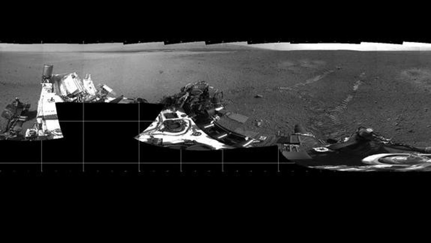 "NASA's Mars rover Curiosity took this panorama on Mars on Aug. 22, 2012, just after its first test drive. The landing site has been named ""Bradbury Landing"" in honor of the late sci-fi author Ray Bradbury."