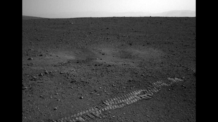 Aug. 22, 2012: The Curiosity rover's wheel tracks on the surface of Mars are seen in an image sent from one of the rover's cameras.