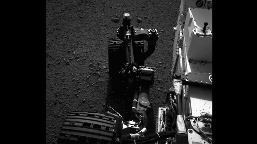 This still from a set of images shows the movement of the front left wheel of NASA's Curiosity as rover drivers turned the wheels in place at the landing site on Mars. Engineers wiggled the wheels as a test of the rover's steering and anticipate embarking on Curiosity's first drive in the next couple of days. This image was taken by one of Curiosity's Navigation cameras on Aug. 21, 2012